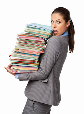 Teacher carrying lots of documents image